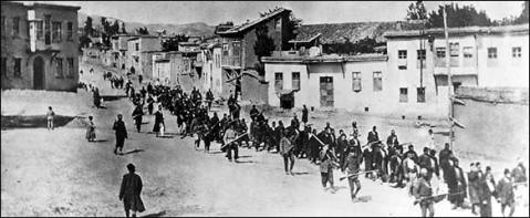 Armenians controlled by armed Turkish soldiers. Kharpert, Armenia, April 1915.