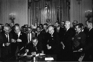 Lyndon B. Johnson signs the Civil Rights Act