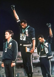 Tommie Smith (center) and John Carlos raise fists for Black Power